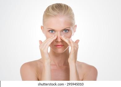 blond girl doing a facial massage