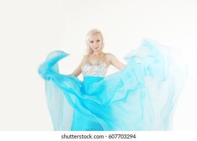 Blond girl in flowing dress