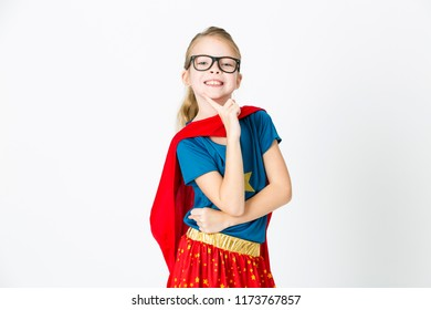 blond girl with glasses and red robe und blue shirt is posing in the studio