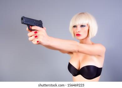blond girl with a gun