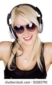 Blond girl listening to music wearing headphones