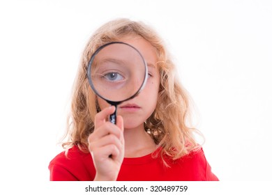 blond girl with magnifying glass in front of white background