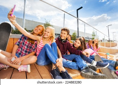 Blond girl making selfie of her and friends