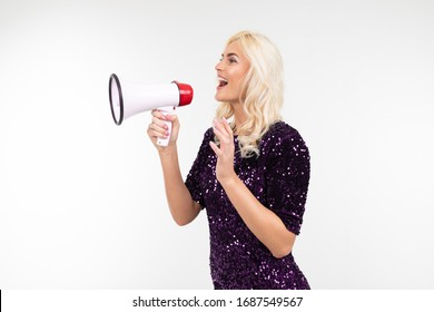blond girl with a megaphone presents news on a white background with copy space