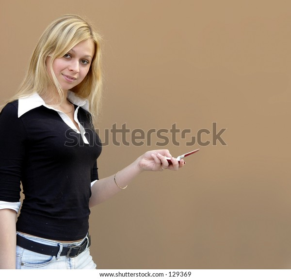 Blond girl with a phone and space for copy