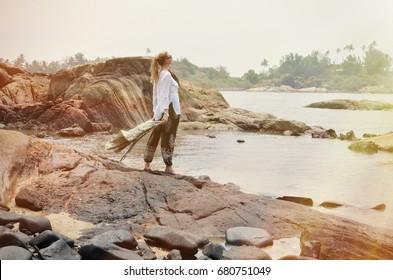 Blond girl relaxing on Agonda beach of South Goa, India