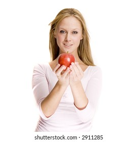 a blond girl is smiling and holding a red apple