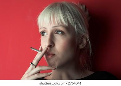 Blond girl smoking.