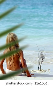 Blond girl watching the sea