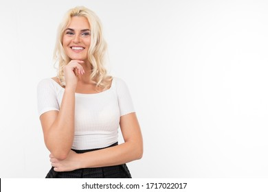 blond girl in a white t-shirt posing on a white background with copy space