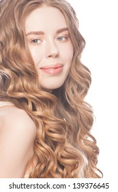 Blond Hair. Young Beautiful Caucasian Woman with Curly Long Hair and Fresh Makeup. Isolated on white background