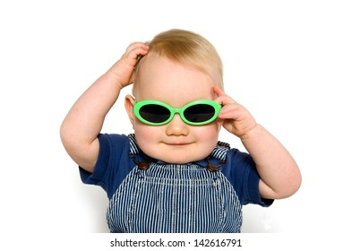 Blond haired baby boy with green sunglasses on white background