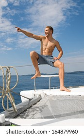 Blond handsome young man on a sailing boat - attractive.