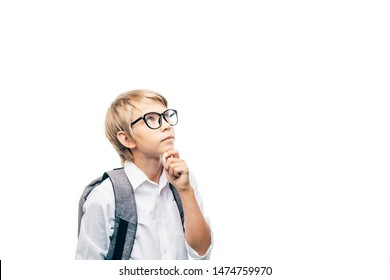 Blond kid in glasses with a backpack reflecting