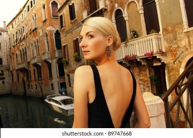 Blond lady on a bridge.