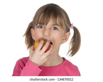 blond little girl eating apple