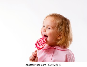 blond little girl have a big happy lollipop