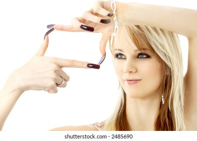 blond with long nails looking through her fingers in a box shape