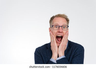 Blond man with glasses just heard he won the lottery. Het is a winner and can't believe it.