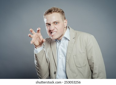 Blond man trying to frighten the viewer