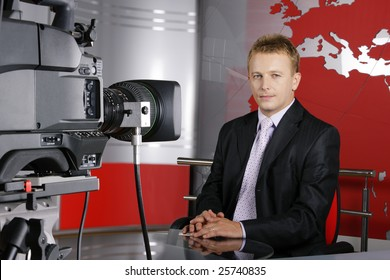 blond middle age news presenter in studio in front of the video camera