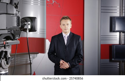 blond middle age news presenter in studio in front of the camera with braking news reports