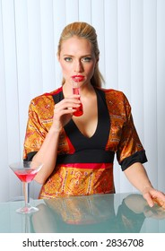 Blond model at bar with red drink