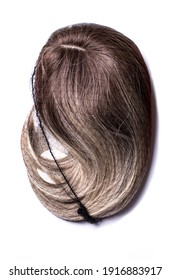A blond ombre wig in the synthetic net isolated on the white background