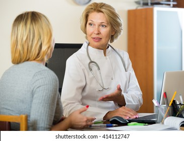 Blond patient and senior therapeutist at appointment in clinic