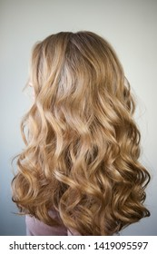 blond with perfect curls, long hair with curls,
