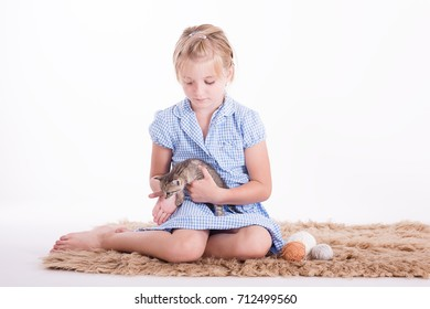 blond school girl with a kitten studio shot on a white background