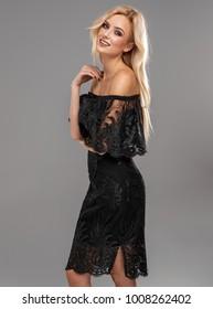 Blond smiling beauty wear black dress