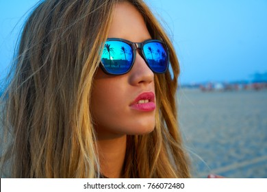 Blond teen girl sunglasses at palm tree summer sunset