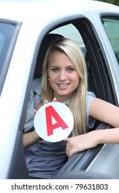Blond teenage learner driver