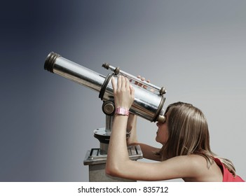 Blond teenager watching the sky through a telescope.