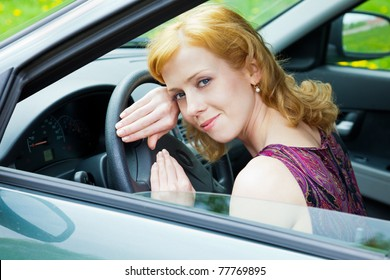 A blond woman behind the wheel