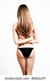 blond woman in bikini, back, studio shot