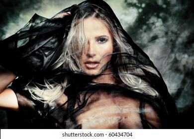 blond woman with black veil studio shot