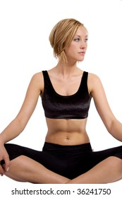 Blond woman doing yoga and sitting in lotus position
