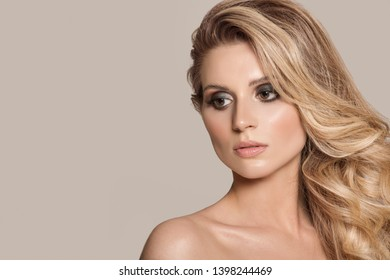 Blond woman face with nude make-up close-up