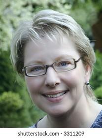 Blond woman with fashion eyeglasses