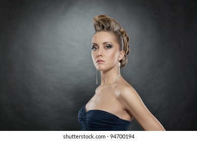 blond woman with fashion hairstyle, grey background