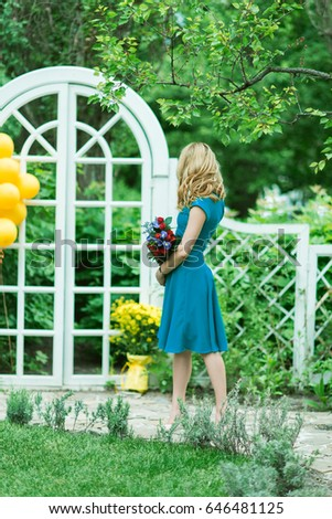 Blond Woman With Flowers Near Birthday Decorations