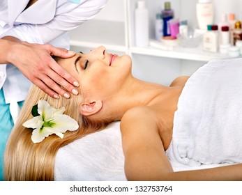 Blond woman getting head massage.