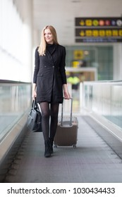 Blond woman going to gate at the airport
