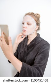 blond woman having a make-up mask on her face