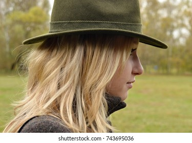 blond woman in hunting hat