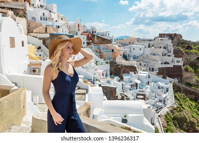 blond woman in Oia on Santorini, staring into the distance