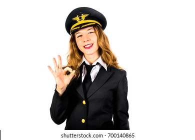 Blond woman pilot in uniform smiles and shows OK sign. Isolated on white background. The modern concept of aviation, flights, and sorting.