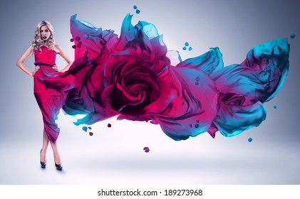 blond woman in pink and blue rose dress
